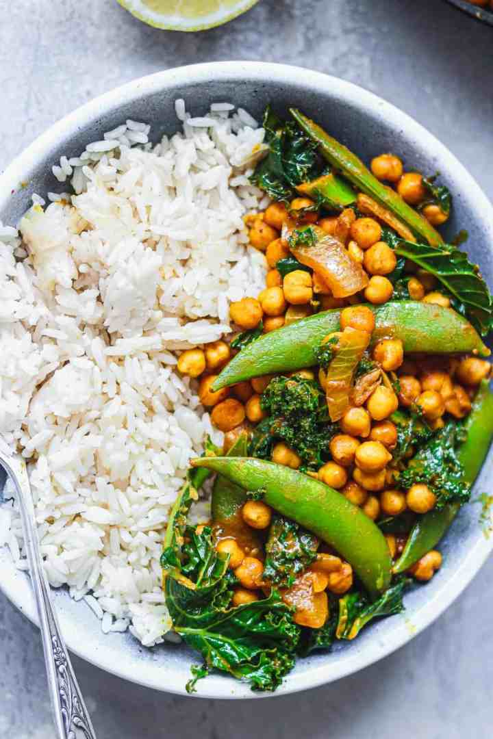 Closeup of vegan curry with chickpeas in a blue bowl