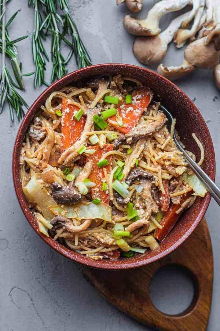 Vegan stir-fry with mushrooms in a brown bowl