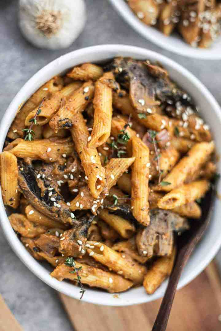 Vegan pasta with mushrooms in a white bowl