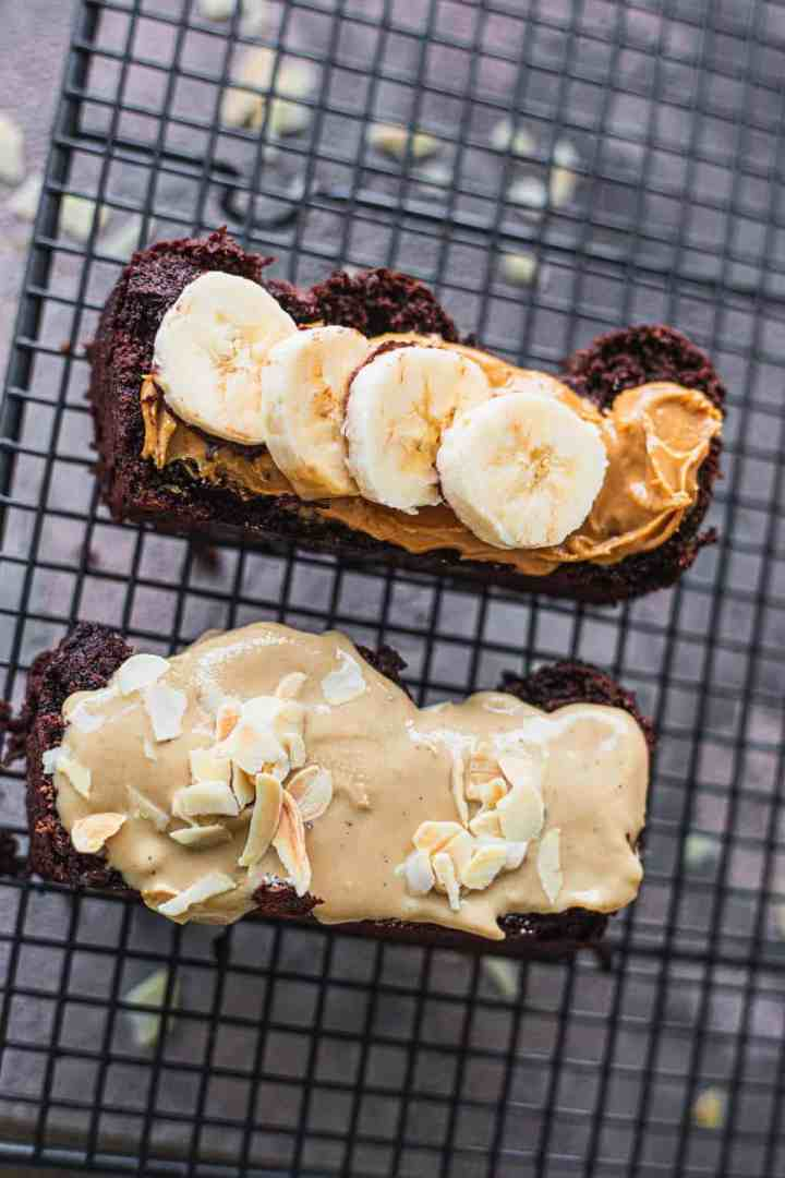 Two slices of vegan banana bread with peanut butter and tahini