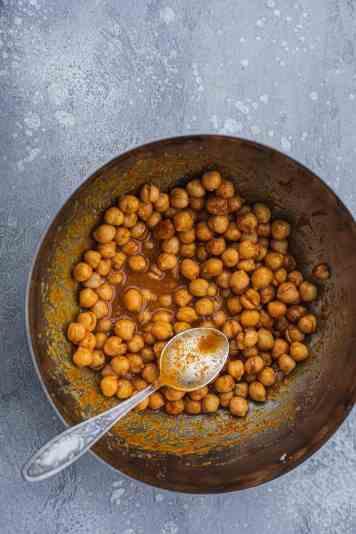 Vegan turmeric tahini chickpeas in a mixing bowl