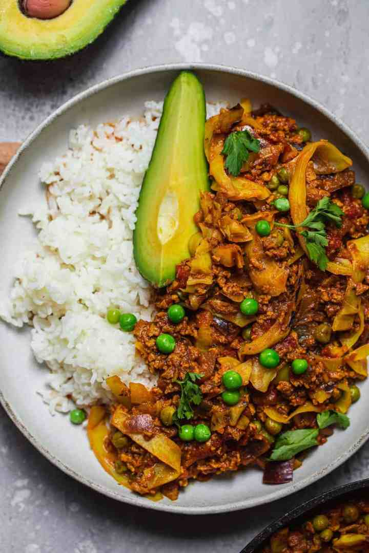 Soy mince stew with peas and avocado over rice