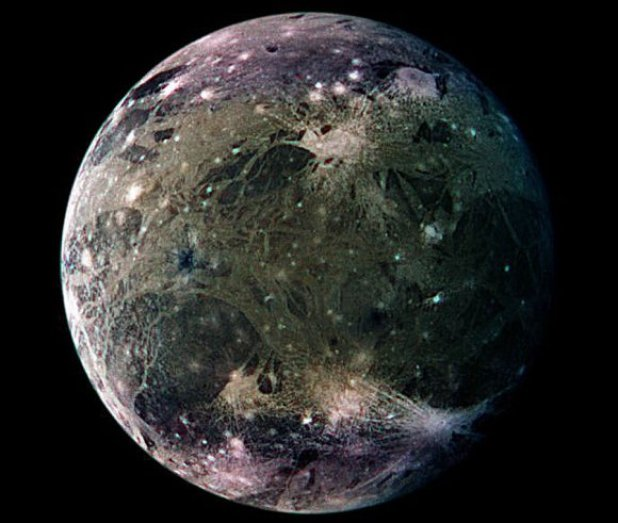 Colorful marble-like moon on a black background.