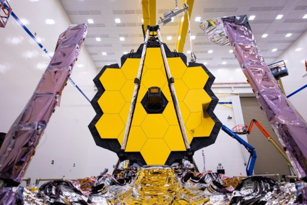 The giant hexagon is made of small hexagons with foil-covered arms in the foreground.