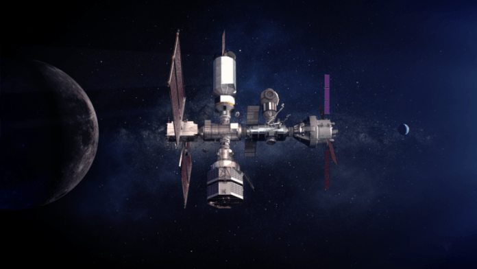 Several large connected cylinders and solar panels, orbiting the moon below.