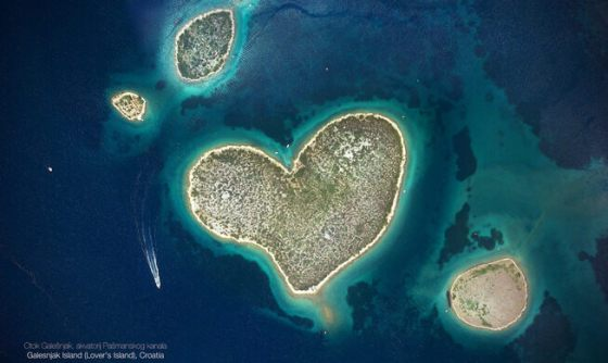 Heart-shaped island surrounded by blue water.