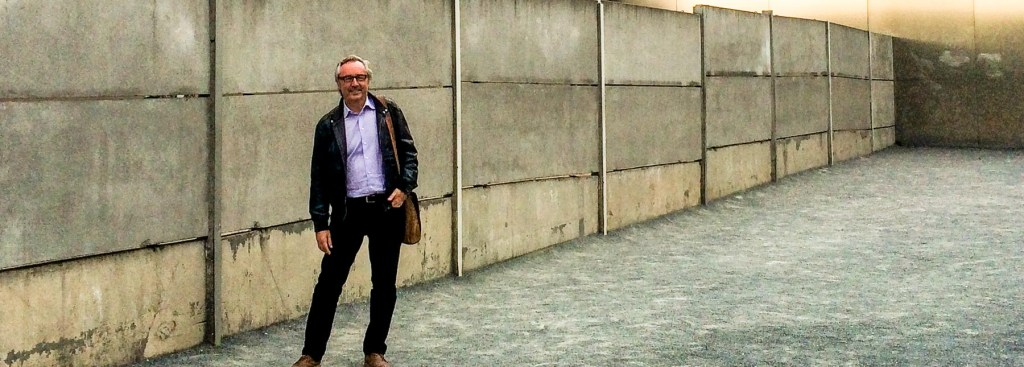 Picture of Andy in front of the Berlin Wall.