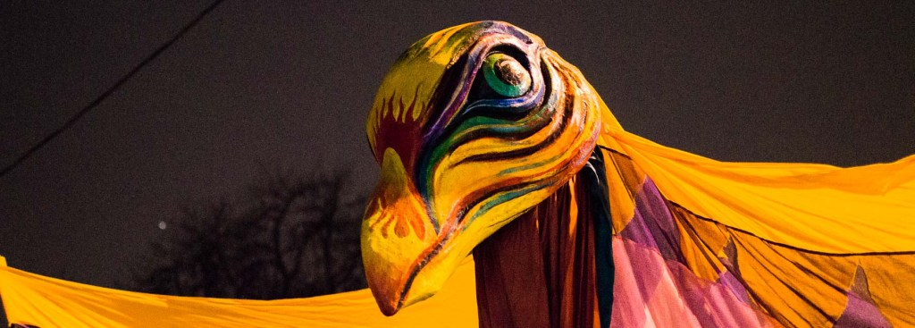 Picture of the technicolor raven in the Solstice Festival parade.