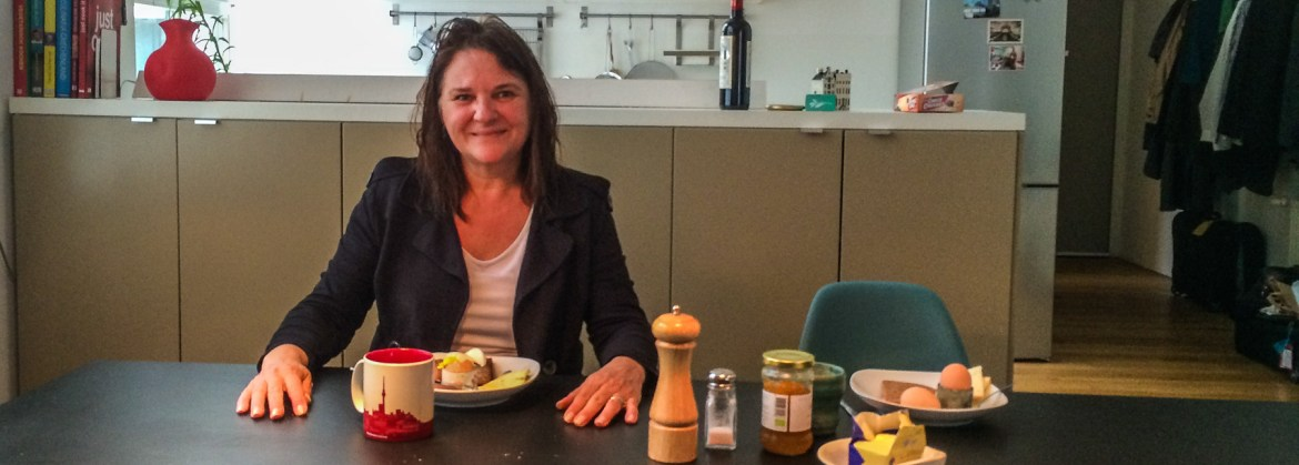 Picture of Marlene having breakfast in our Berlin loft rental. An advantage if you're renting Airbnb or VRBO