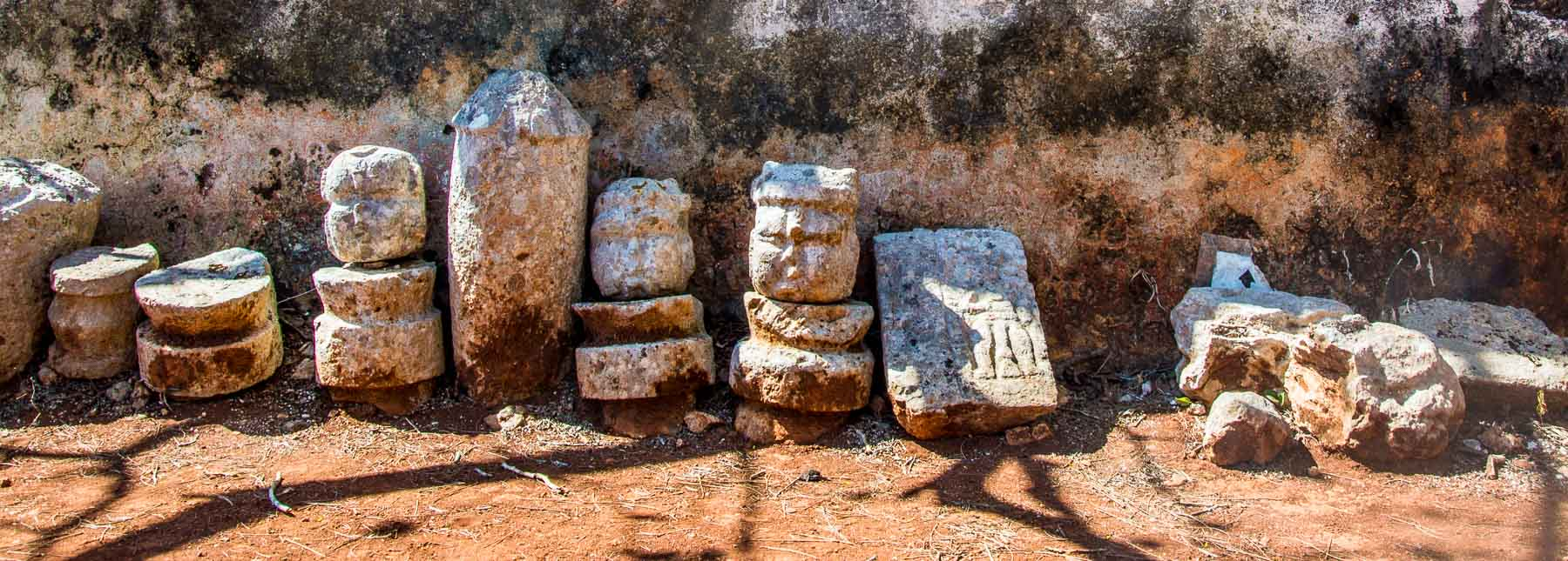 Carved rocks with Mayan faces.