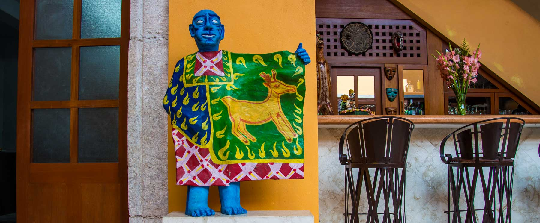 Sculpture of blue man holding a deer banner in the Valladolid house.