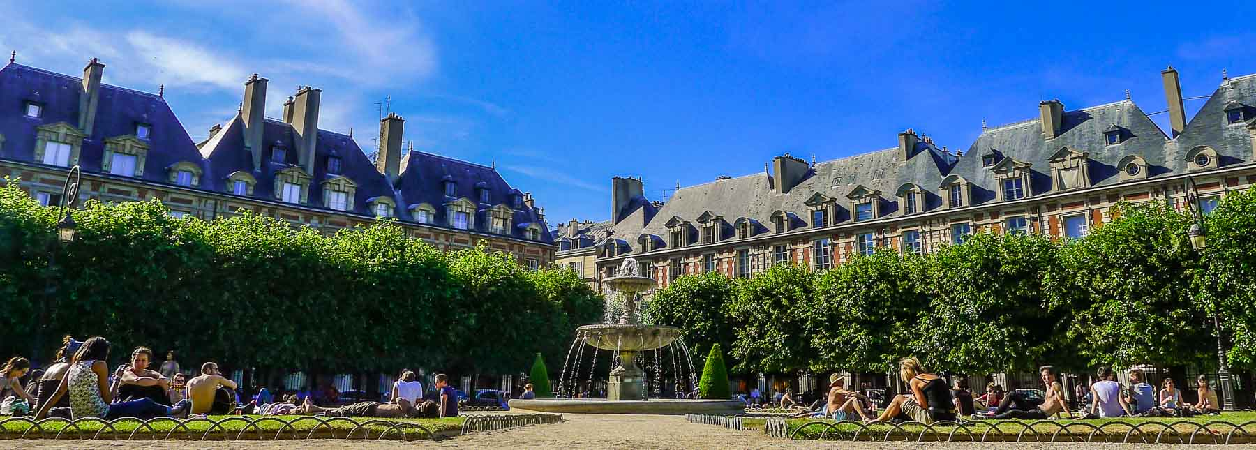People on the lawns at Place de Vosges.