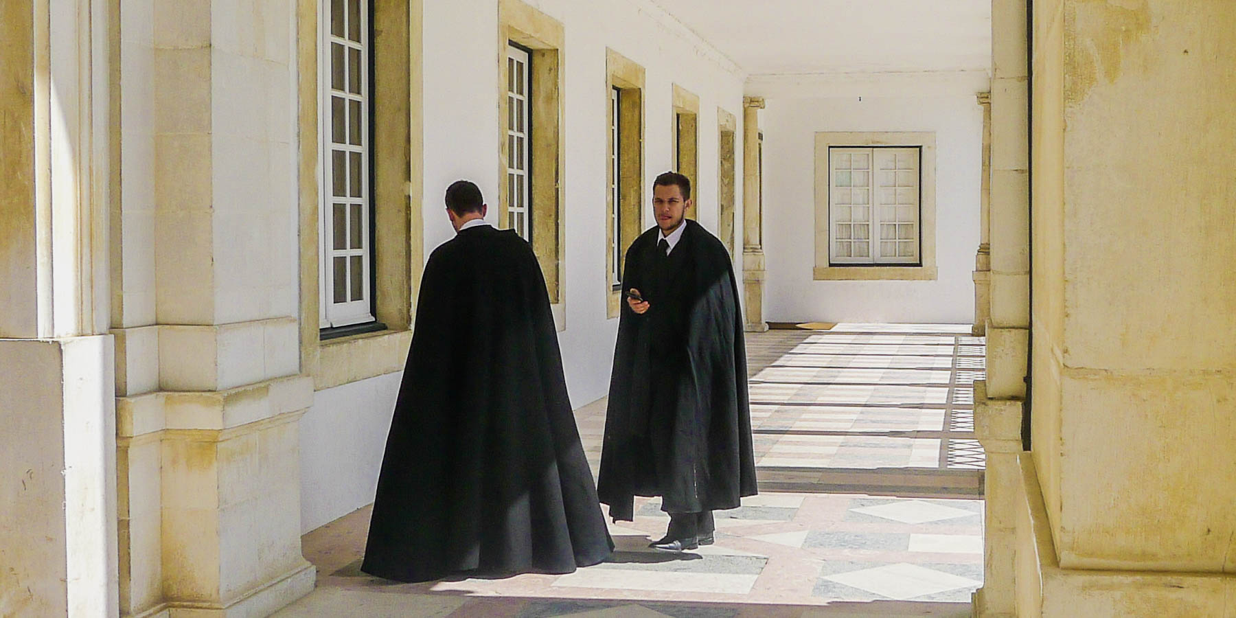 Portuguese university students wearing Harry Potter capes.