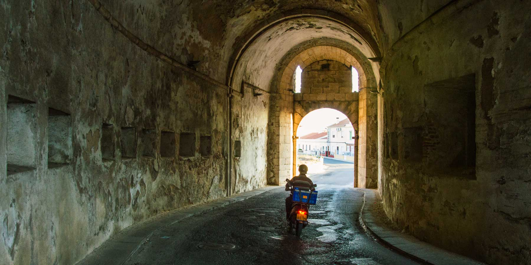 View of the tunnel through an old city wall.
