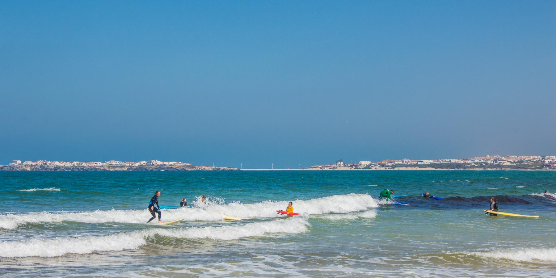 Renting a car in Portugal means you can get off the highway to watch people learning to surf.