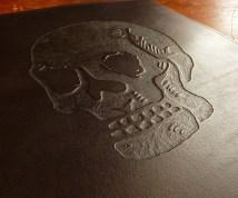 Custom skull design on black leather ring binder - Earthworks Journals