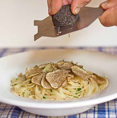Shaving fresh Summer Truffles over warm Spaghettini al Beurre