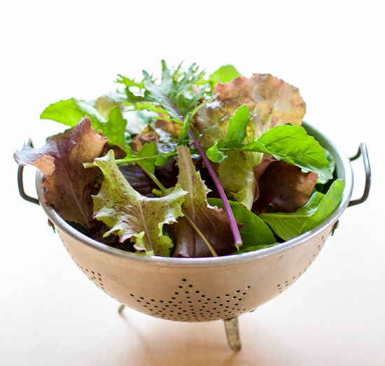 Colander of fresh garden greens