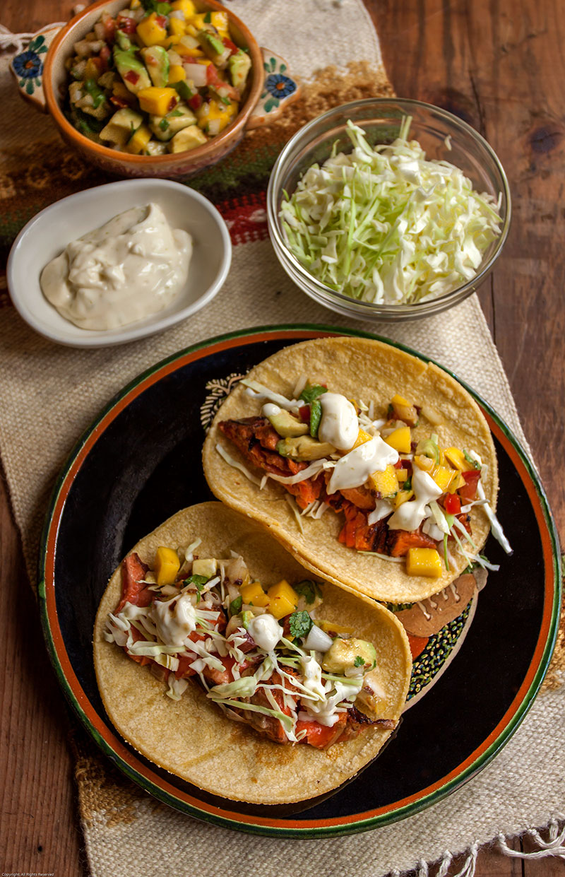 Grilled salmon tacos with condiments