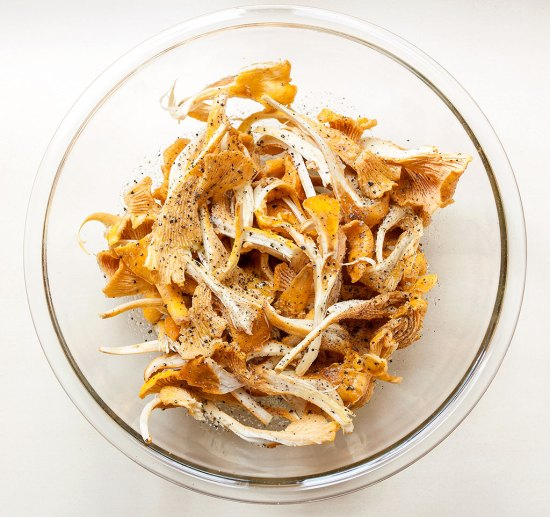 Chanterelles in a bowl with salt & pepper