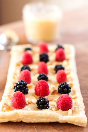 Pawpaw curd on puff pastry with berries