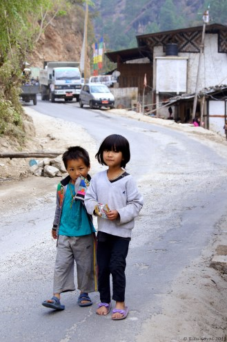 """""""The child's naive dream of life is the only one worth having."""" ― Marty Rubin. Children loitering about on the road in their village near Wangdue"""