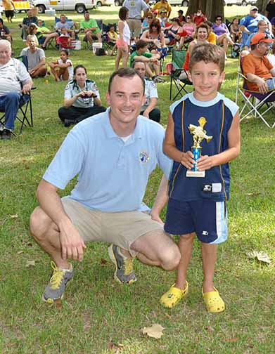 Most Fish boys ages 5-7 Caleb Gautreau pictured with Councilman Chris Loar.  Photo by Teri Henry