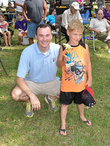 Biggest Fish ages 5-7 Kayden Roussel pictured with Councilman Chris Loar.  Photo by Teri Henry