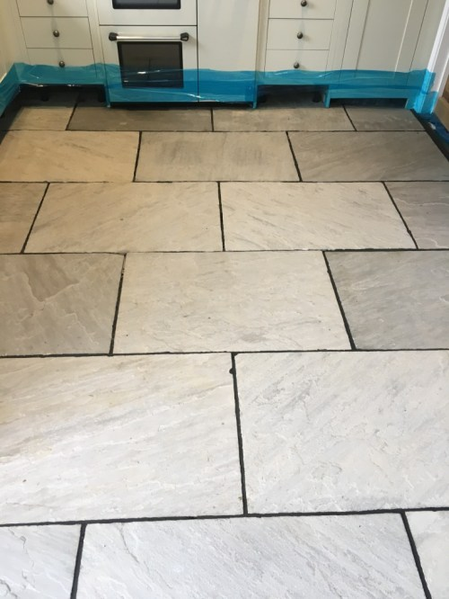 Flagstone floor during restoration Vines Cross
