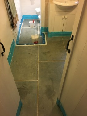 Green Slate Tiled Floor During Cleaning Hastings