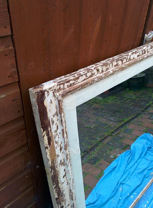 mirror framed half stripped