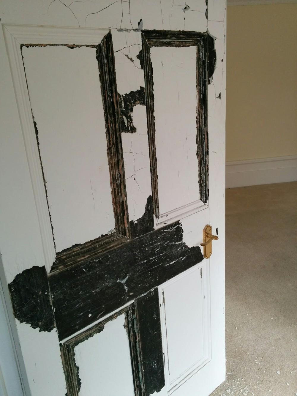 Living room door paint peeling
