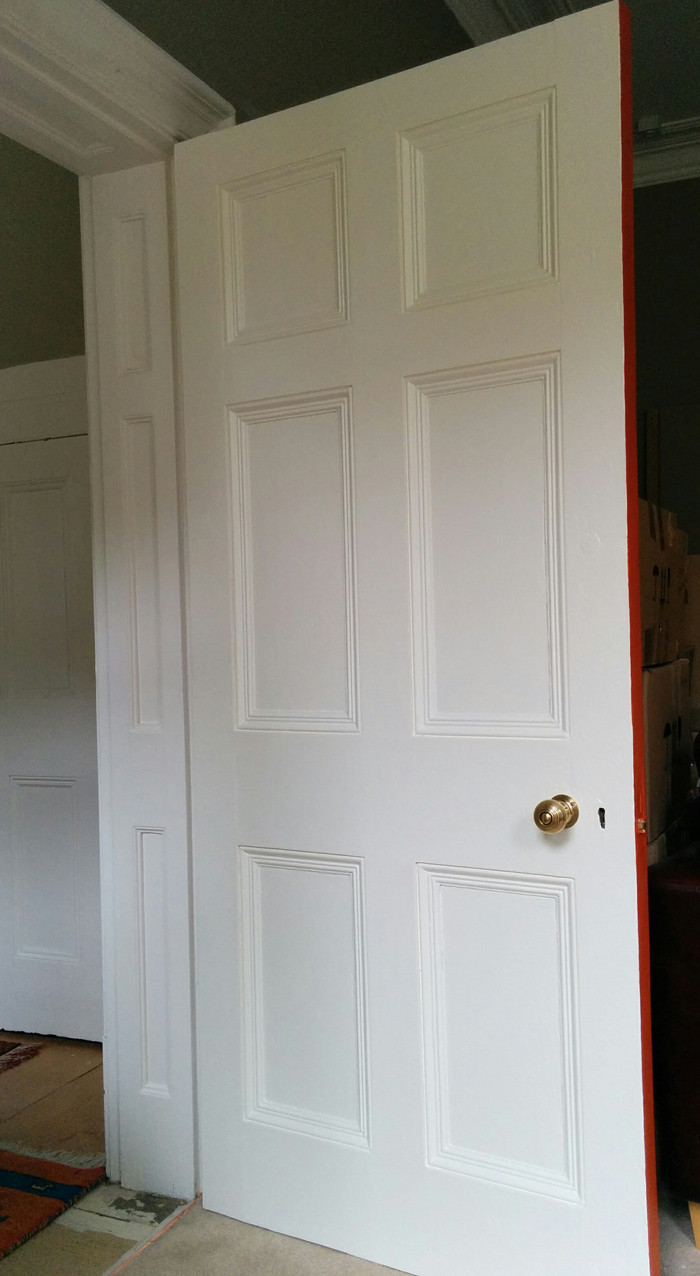Living room door finished in Farrow & Ball Pointing