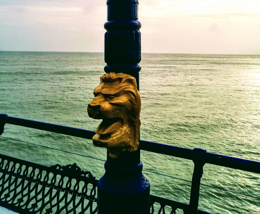 gold lion head on Eastbourne pier