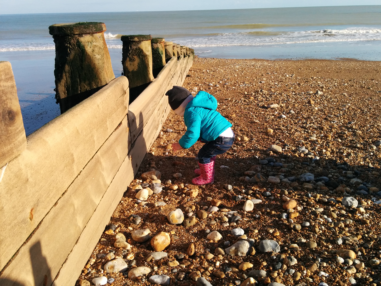 Hazel picking up stones