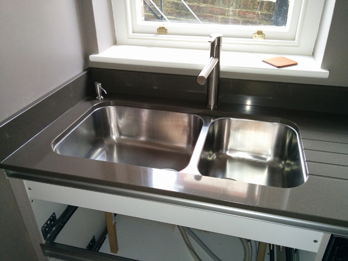 new worktop in place, sink and tap
