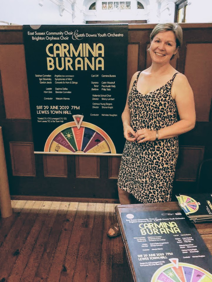 Robin with the poster she designed for Carmina Burana