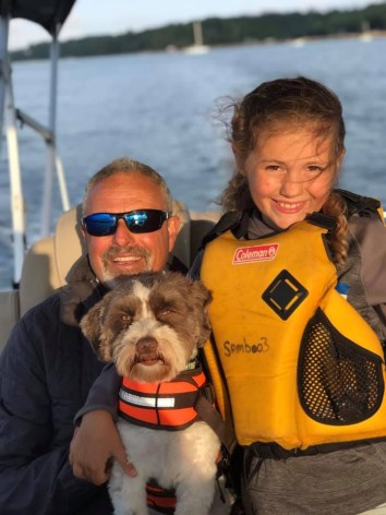 Skipper Tony Sampson with daughter Isabelle and their doggy too