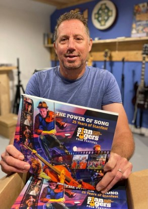 Troy Greencorn with his book THE POWER OF SONG - 25 YEARS OF STANFEST