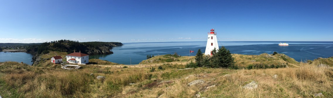 swallowtail lighthouse, ferry heading out to sea – best spot on the island