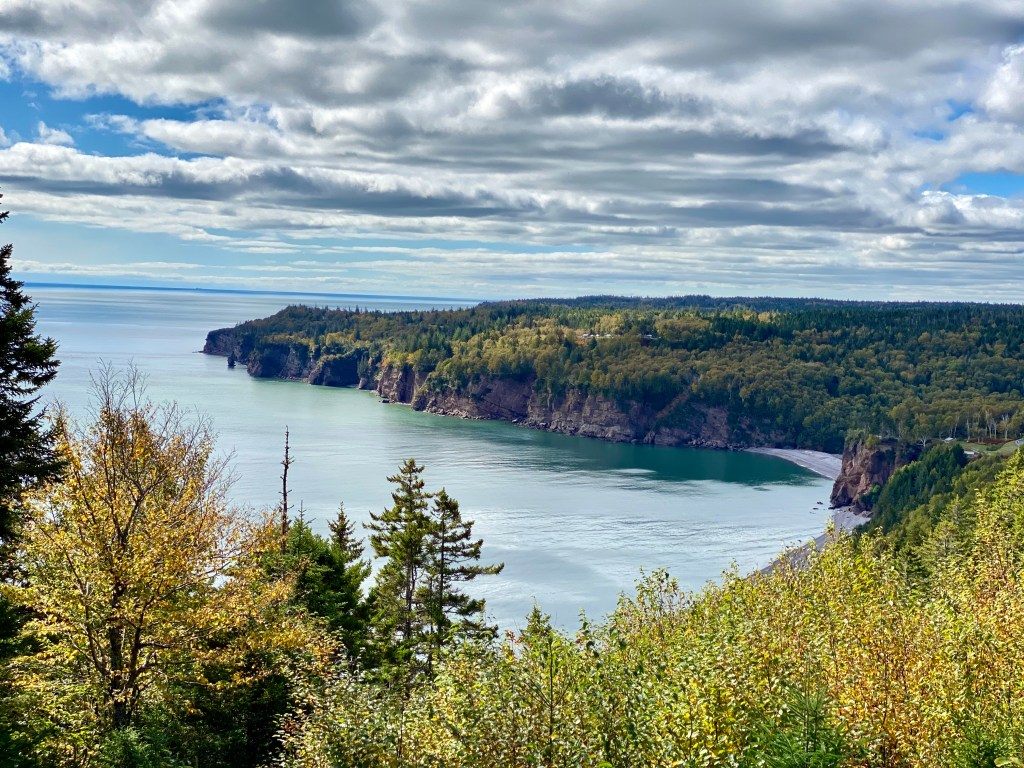 Crystal Richard enjoying the views at the Fundy Trail in New Brunswick, one of her favourite Summer Haunts for road trips.