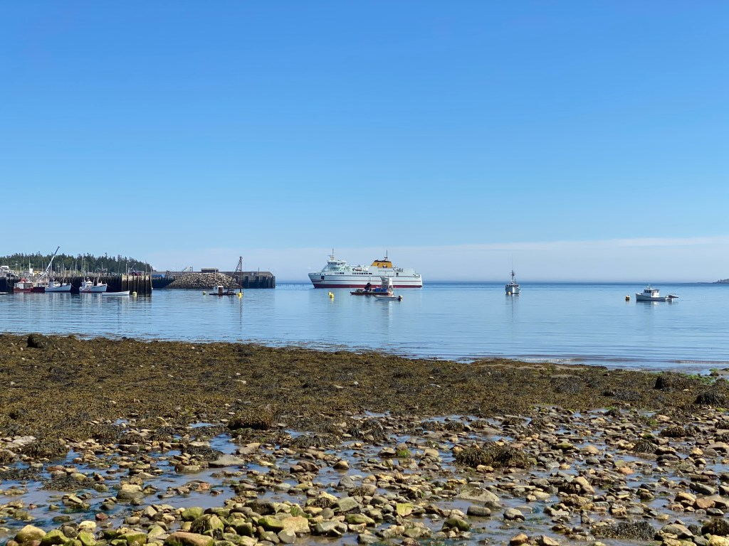 The ferry coming in on the water viewed from Surfside Motel on Grand Manan.