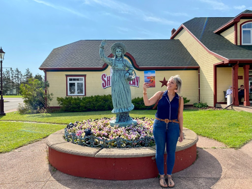 Crystal Richard and a statue of Anne of Green Gables near the tourist center in Prince Edward Island