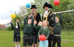 A photo of the new Lord Mayor of Exeter, Councillor Peter Holland, with children from Trinity C of E Primary School. Picture: Exeter City Council