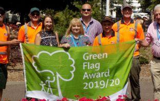 A Green Flag Award went to Manor Gardens, in Exmouth. (left to right): Andy Vinnicombe, Peter Hooker, Simon Kennedy, Andy Gordon-Raby (StreetScene), Cllr Jung, Lorna Christo (parks improvement officer), Sharon Scott, Luke Spiller (StreetScene) Photo: EDDC