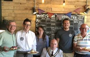 Pictured at the new Axminster waffle house are (l-r) Cllr Ian Hall, ward member, Waffle directors Tim Whiteway and Sophie McLachlan, Cllr Stuart Hughes EDDC chairman, Waffle director Matt Smith and Cllr Andrew Moulding, ward member. Picture: EDDC