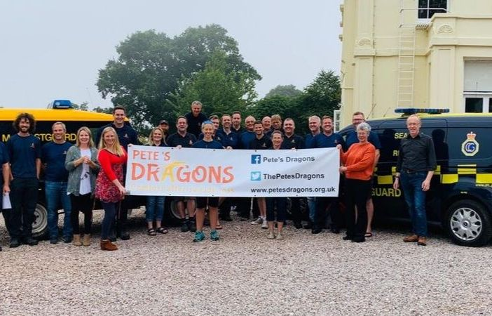 The Pete's Dragons team with members of HM Coastguard.