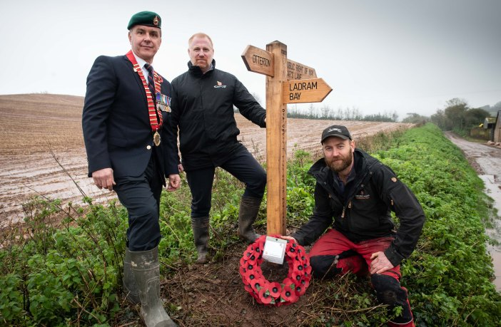 (l-r) Otterton Parish Council chairman, Councillor John Hiles, Steven Harper-Smith from Ladram Bay Holiday Park and Ranger Ed Lagdon from Clinton Devon Estates with one of the new waymarker signs that honour the World War One heroes. Picture: Guy Newman/Rekord Media