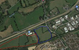 The Honiton Hayne Lane site. In blue is land owned by East Devon District Council and in red is a plot owned by Combe Estates.