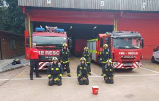 Fundraising firefighters from Clyst St George on their 20-mile walk to mark the 20th anniversary of September 11. Image: Devon and Somerset Fire and Rescue Service